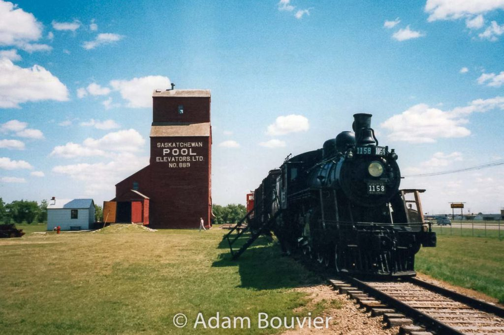 CN 1158 and grain elevator in North Battleford, SK, July 2003. Contributed by Adam Bouvier.