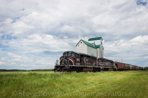 CEMR 5311 passing the Sanford, MB grain elevator, June 2015. Contributed by Steve Boyko.