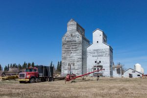 Two old wooden grain elevators in the small town of Isabella, MB.