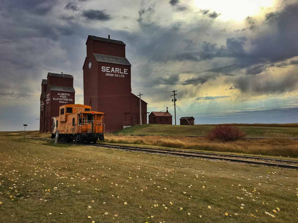 Rowley, AB grain elevators and caboose. Contributed by Jenn Tanaka.