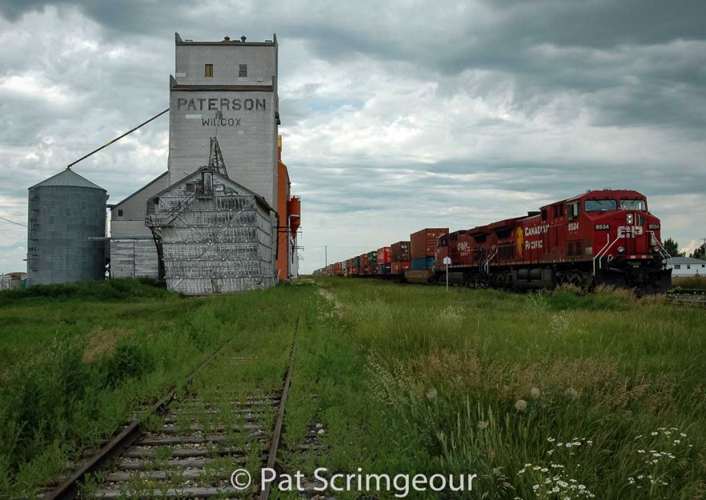 Train and grain elevators in Wilcox, SK, July 2005. Contributed by Pat Scrimgeour.