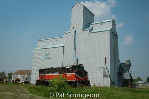 Locomotive at grain elevator in Arborfield, SK, June 2006. Contributed by Pat Scrimgeour.