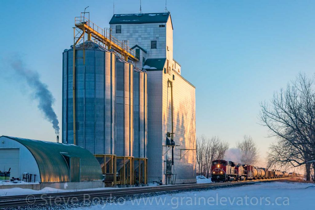 CN 8953 passes the Oakville, MB grain elevator, Dec 2017. Contributed by Steve Boyko.