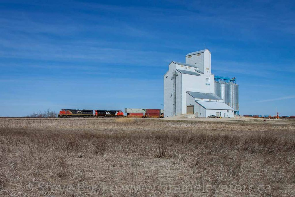 CN train passing the Norman, MB grain elevator, April 2016. Contributed by Steve Boyko.