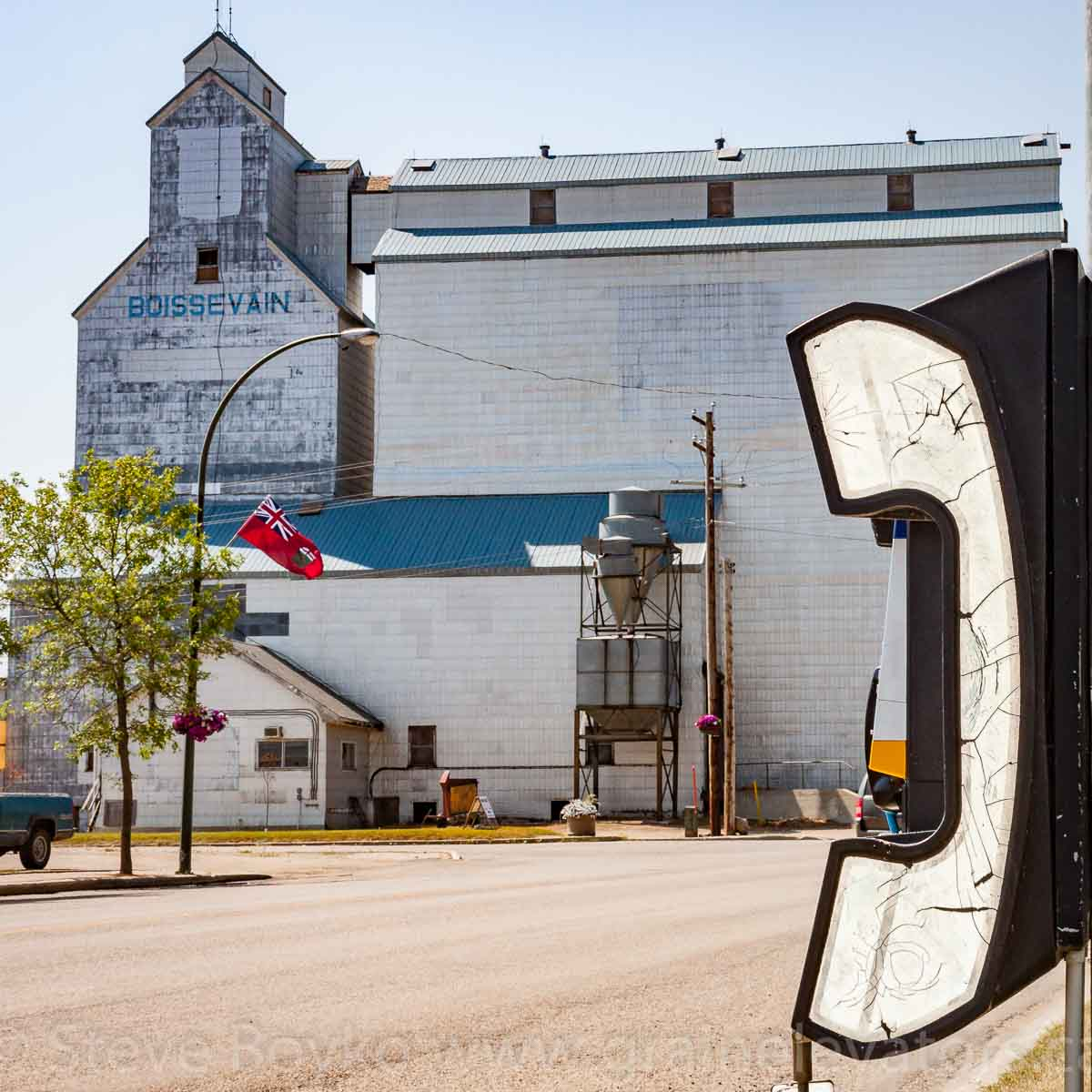 Telephone and ex UGG grain elevator, Boissevain, MB. Aug 2014. Contributed by Steve Boyko.