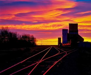 Grain elevator sunrise at Ponteix, SK. Copyright by Bob St. Cyr.