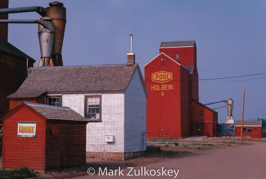 "Holbein, SK ""B"" grain elevator. Contributed by Mark Zulkoskey."