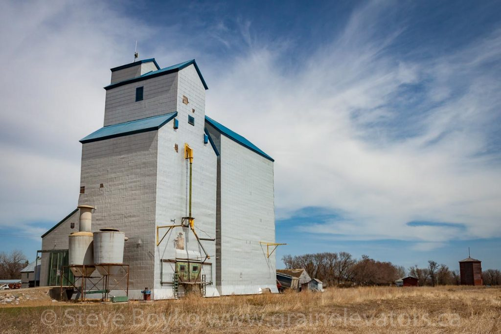 Clearwater, MB grain elevator and water tower, May 2014. Contributed by Steve Boyko.
