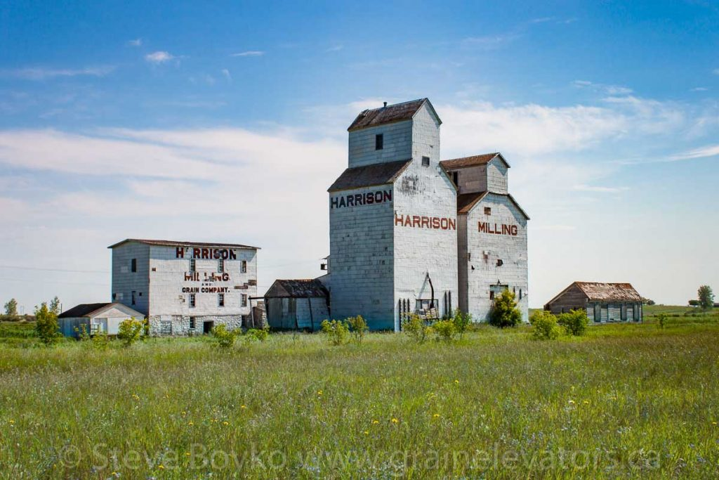 Harrison Mill and grain elevator in Holmfield, MB, Aug 2014. Contributed by Steve Boyko.