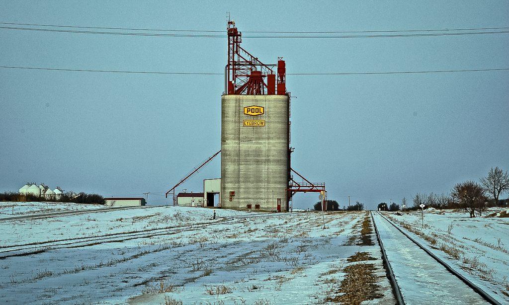 A concrete Saskatchewan Wheat Pool grain elevator in Eyebrow, SK, Jan 2007. Copyright by Gary Rich.