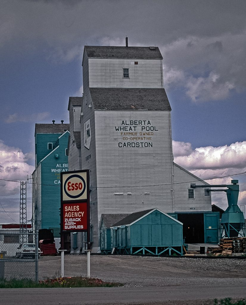 Grain elevators in Cardston, AB, May 1992. Copyright by Gary Rich.
