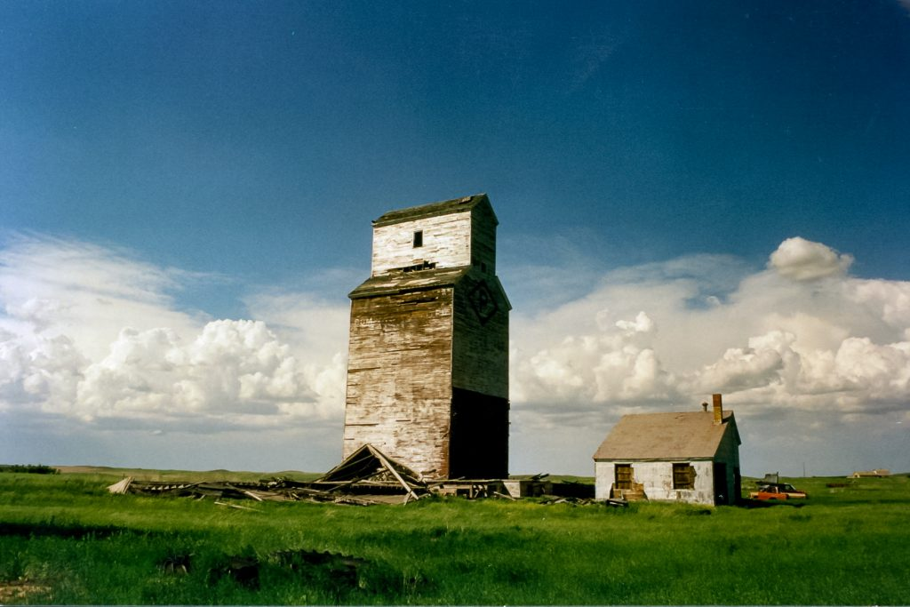 Grain elevators in Verlo, SK, June 2002. Copyright by Robert Boyd.