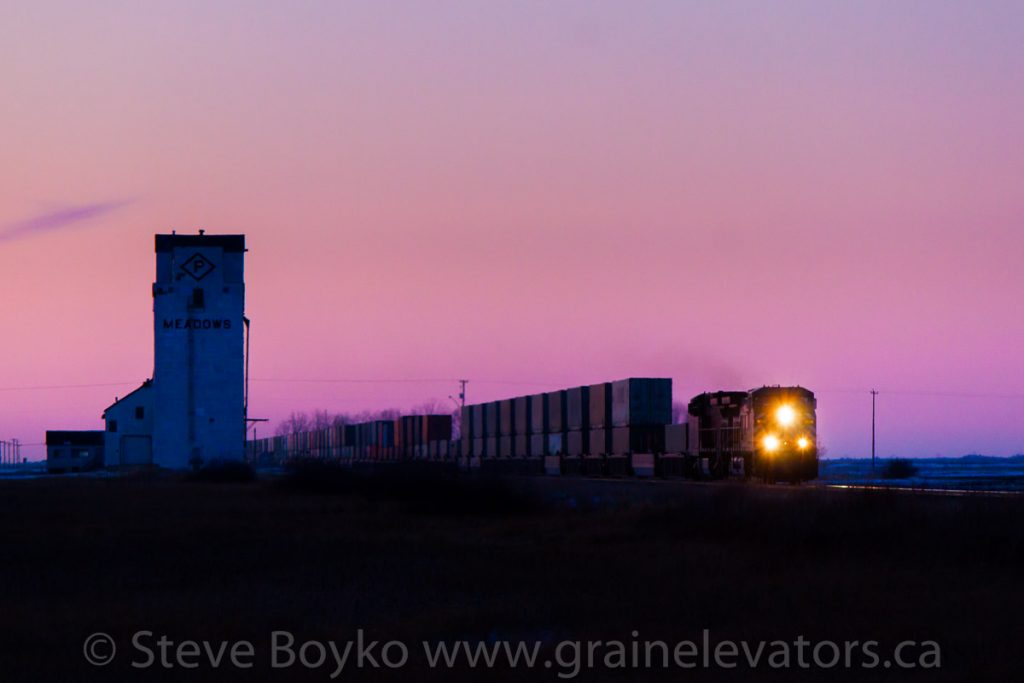 A CP train passing the Meadows, MB grain elevator, Jan 2012. Contributed by Steve Boyko.