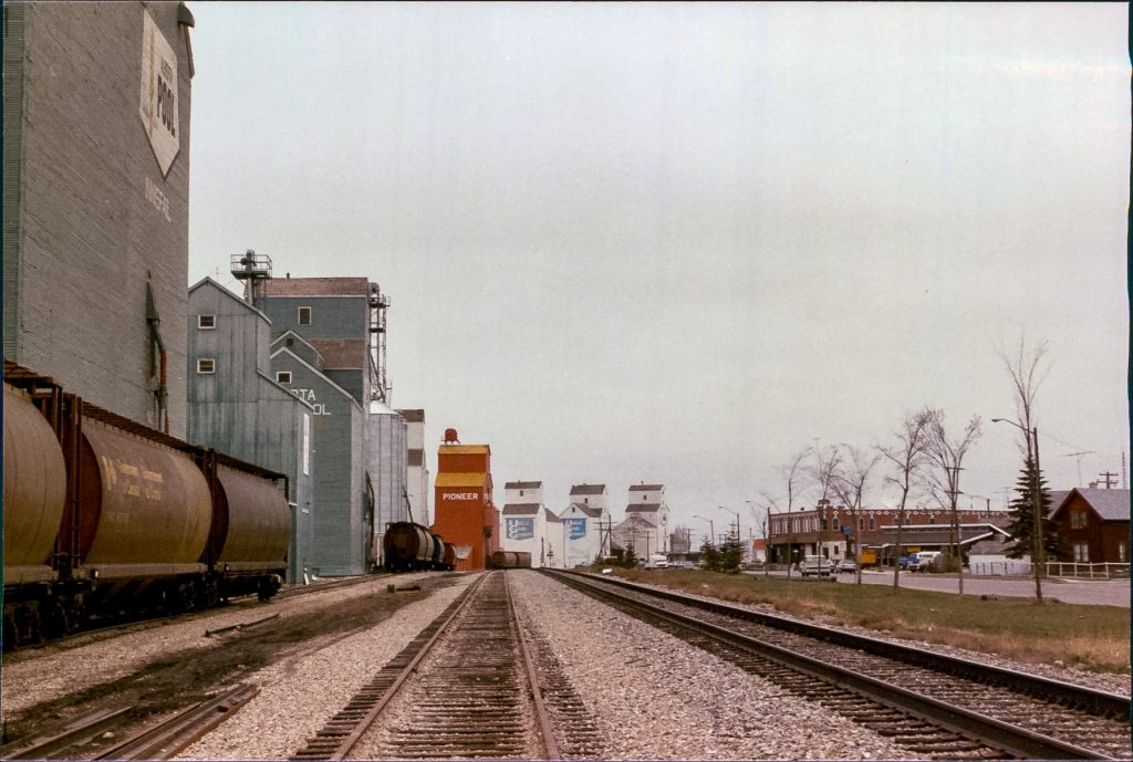 Grain elevators in Innisfail, AB, May 1986. Copyright by Robert Boyd.