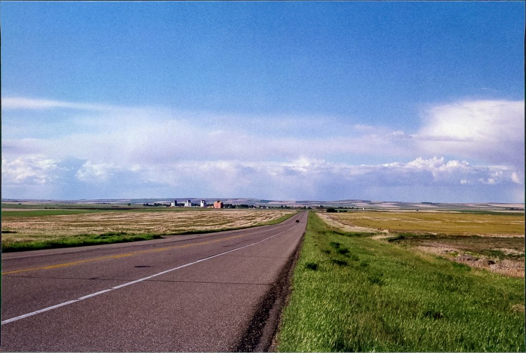 The road to Champion and its grain elevators, June 1999. Copyright by Robert Boyd.