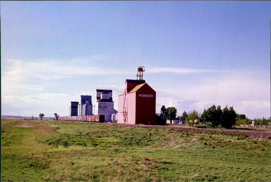 Grain elevators in Champion, AB, June 1999. Copyright by Robert Boyd.