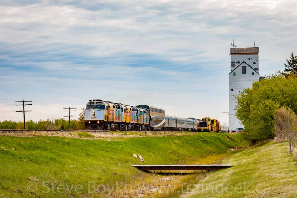 "The VIA Rail ""Canadian"" passing the Dugald, MB grain elevator, May 2017. Contributed by Steve Boyko."