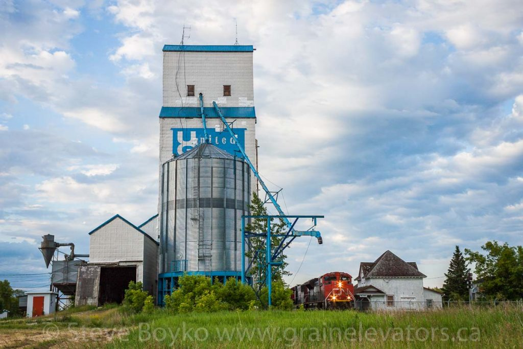Train and grain elevator at McCreary, Manitoba, June 2015. Contributed by Steve Boyko.
