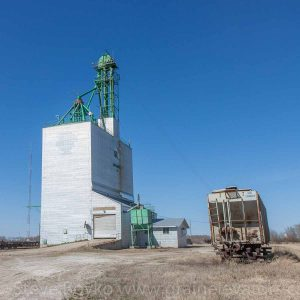 Grain elevator and stranded grain car in Solsgirth, MB, Apr 2016. Contributed by Steve Boyko.