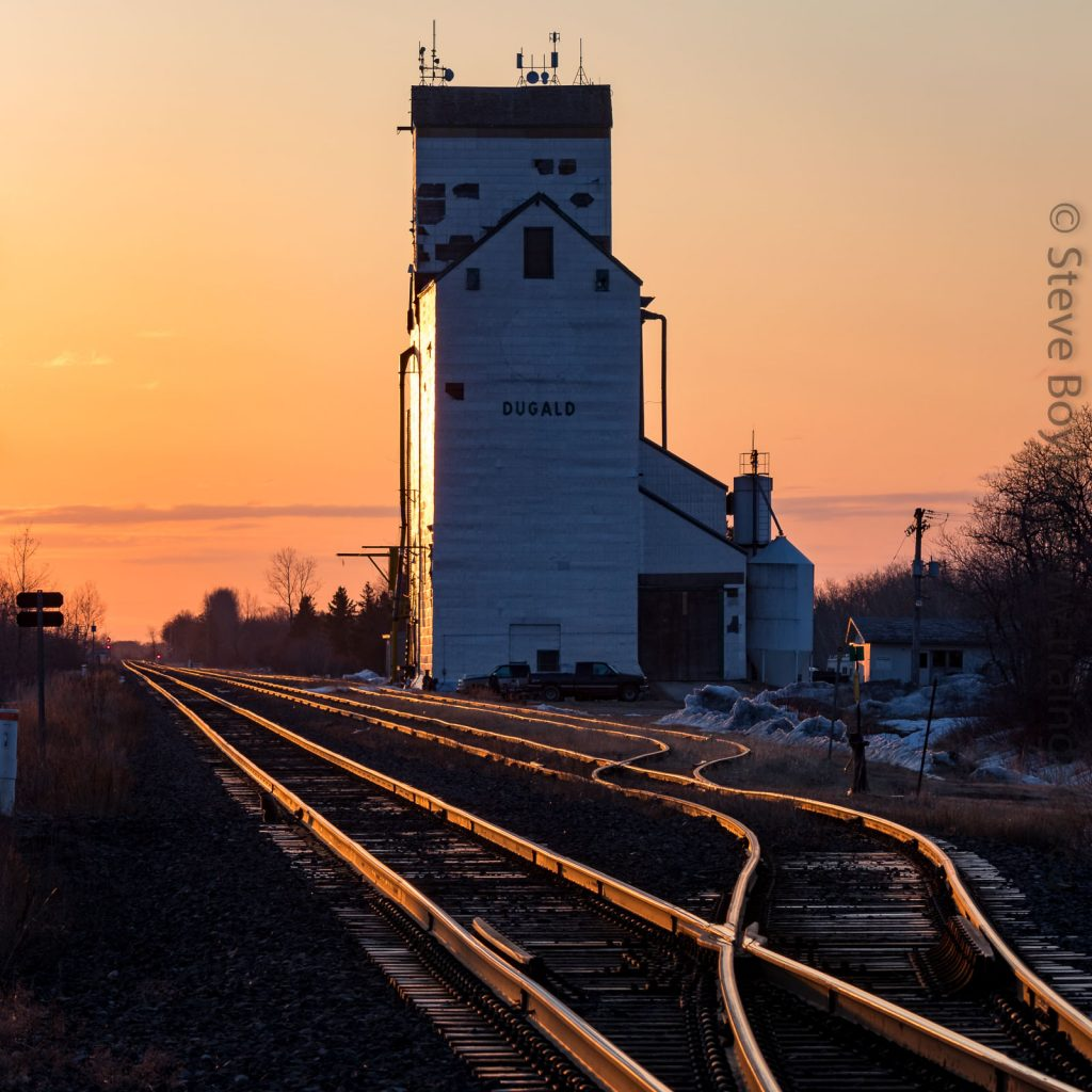 Dugald, MB grain elevator at sunrise, Apr 2018. Contributed by Steve Boyko.