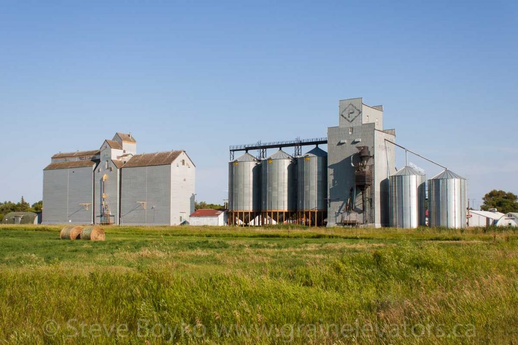 Two grain elevators in Pierson, MB, Aug 2014. Contributed by Steve Boyko.