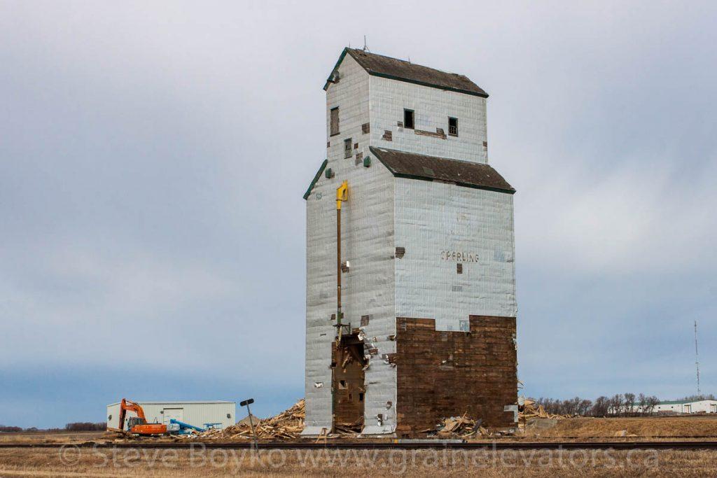 Demolition in progress on Sperling, MB grain elevator, Mar 22, 2015. Contributed by Steve Boyko.