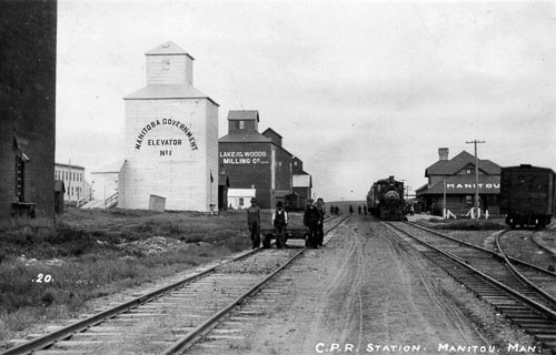 Manitou, MB grain elevators and station, circa 1910.