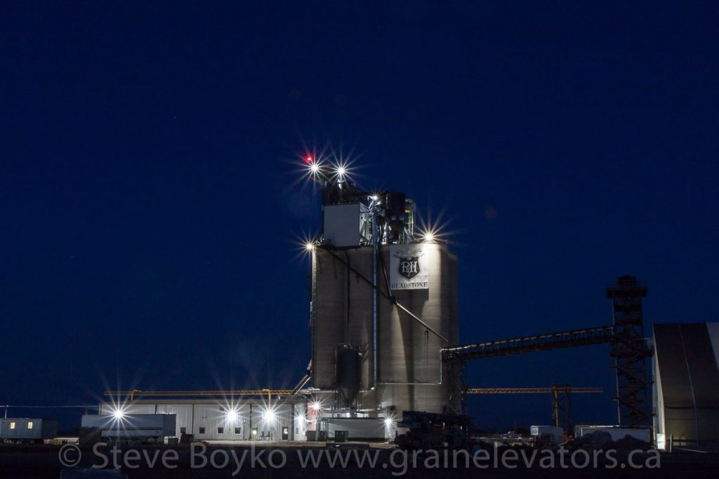 Parrish and Heimbecker grain elevator at night at Gladstone, MB, Apr 2016. Contributed by Steve Boyko.