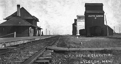 Lyleton, MB grain elevators and train station, circa 1910.