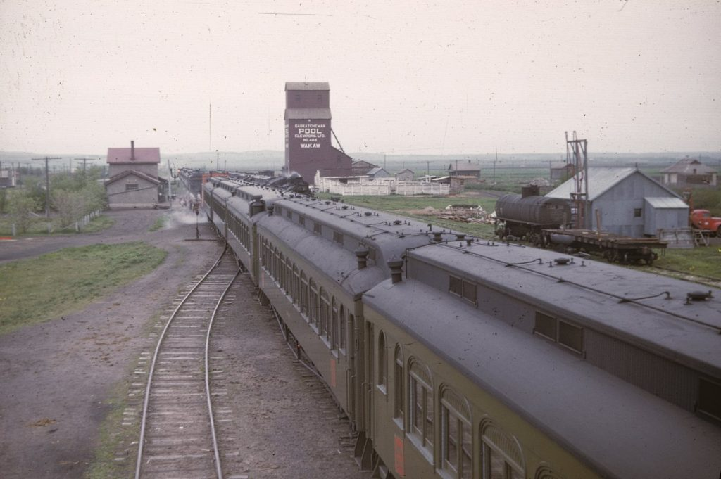 Wakaw, SK grain elevator and train, 1940s, Everett Baker slide.