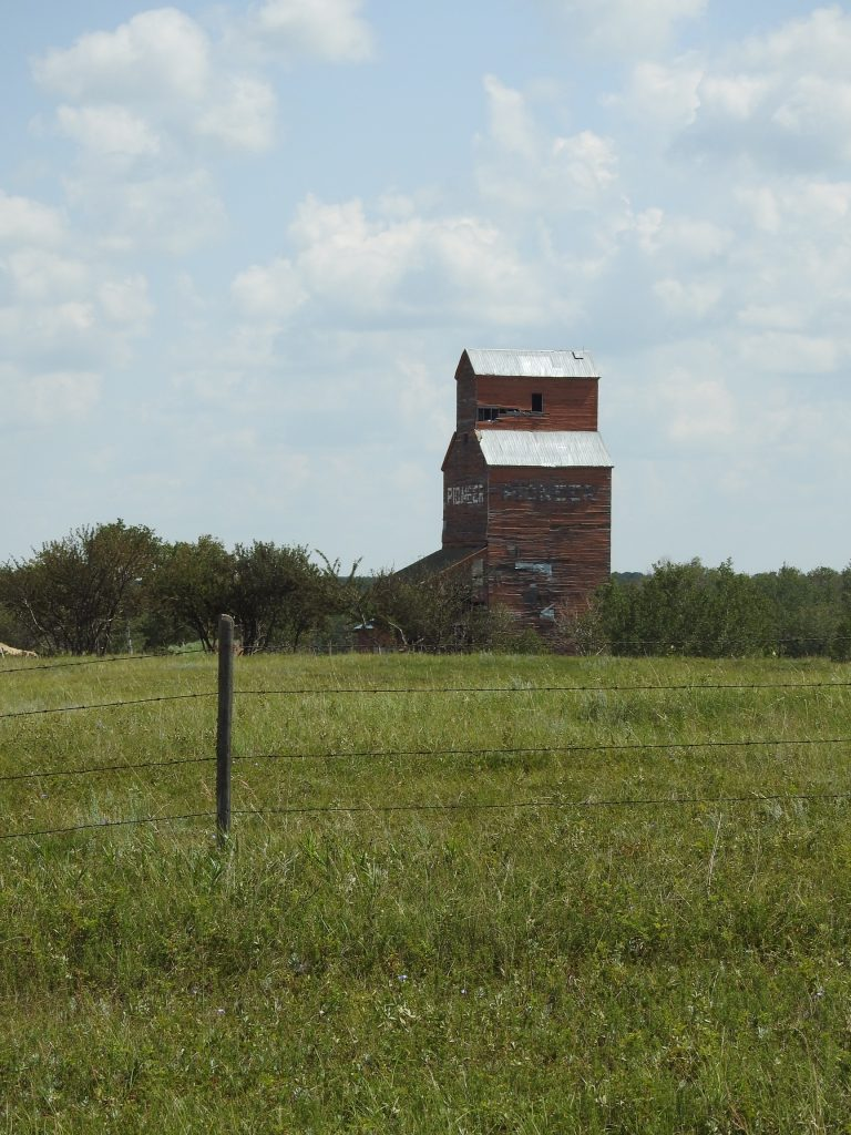 The ex Pioneer grain elevator in Rex, AB, July 2018. Contributed by BW Bandy.