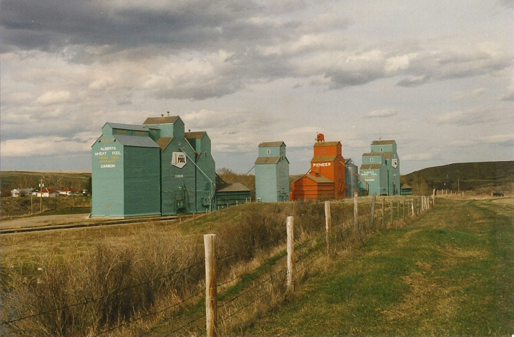 Grain elevators in Carbon, SK. Copyright by Peter Kroeger.