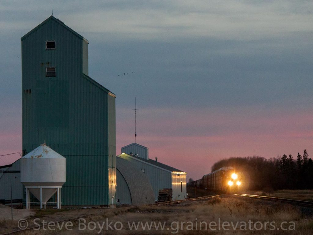 Train passing fertilizer elevator in Niverville, Oct 2012. Contributed by Steve Boyko.