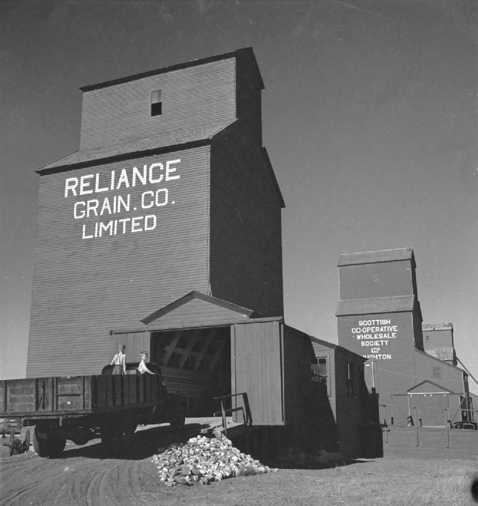 Grain elevators in Stoughton, SK, 1950.
