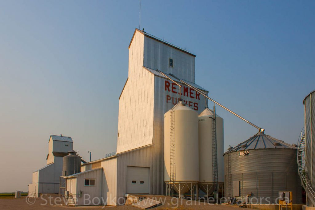 The Reimer grain elevators in Purves, MB, July 2014. Contributed by Steve Boyko.