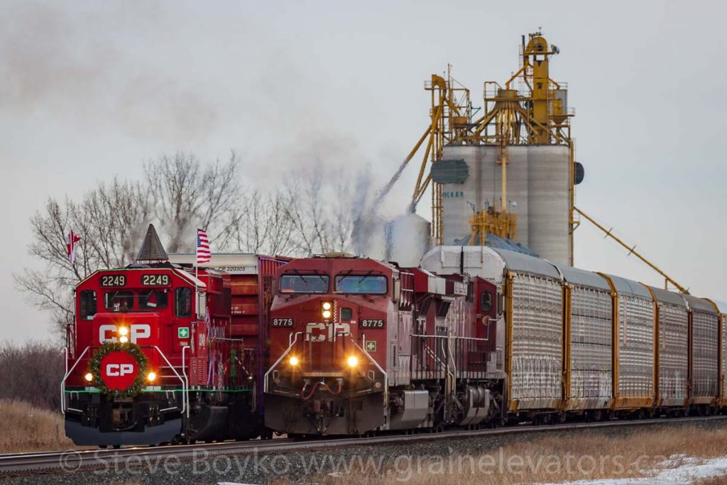 The CP Holiday Train passes a freight train at the Tucker grain elevator