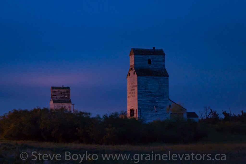 Early morning view of grain elevators at McConnell, MB, Aug 2019.