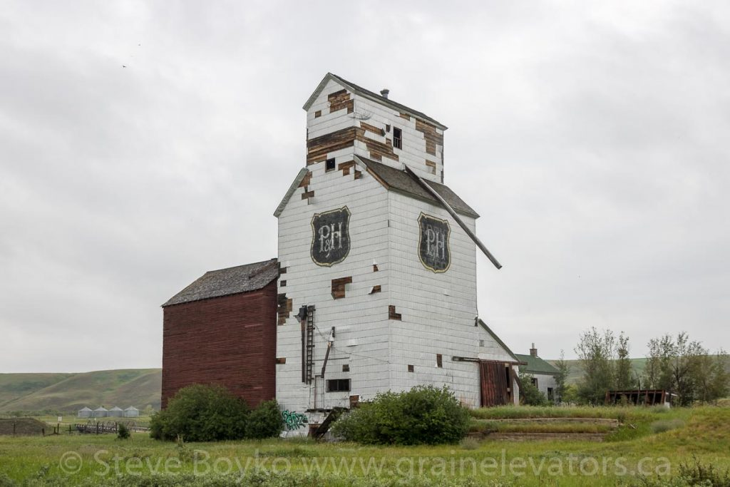 Ex Parrish & Heimbecker grain elevator in Sharples, AB, June 2018. Contributed by Steve Boyko.