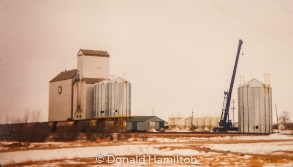 Westeel Bins being added by Litz Crane, Solsgirth, MB Feb 1991. Contributed by Donald Hamilton.