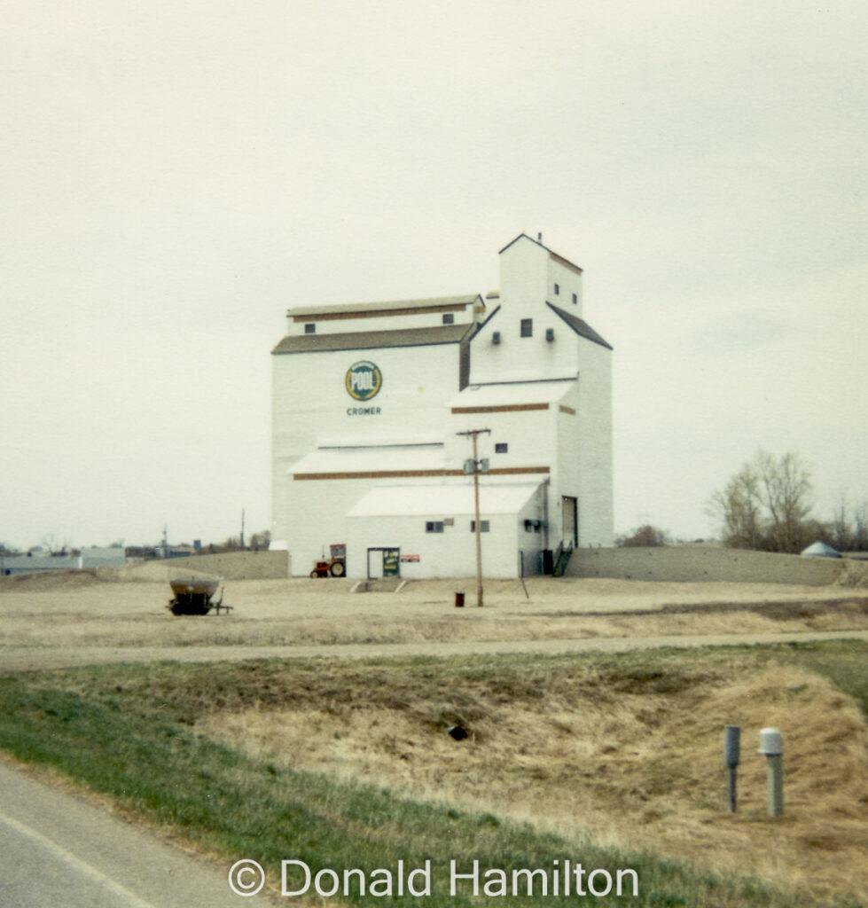 Manitoba Pool grain elevator in Cromer, July 1989. Copyright by Donald Hamilton