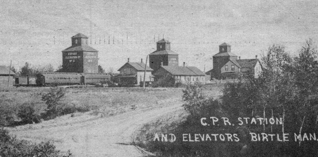 Grain elevators and train station, Birtle, MB, date unknown
